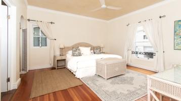Poolside suite bedroom in Hermanus